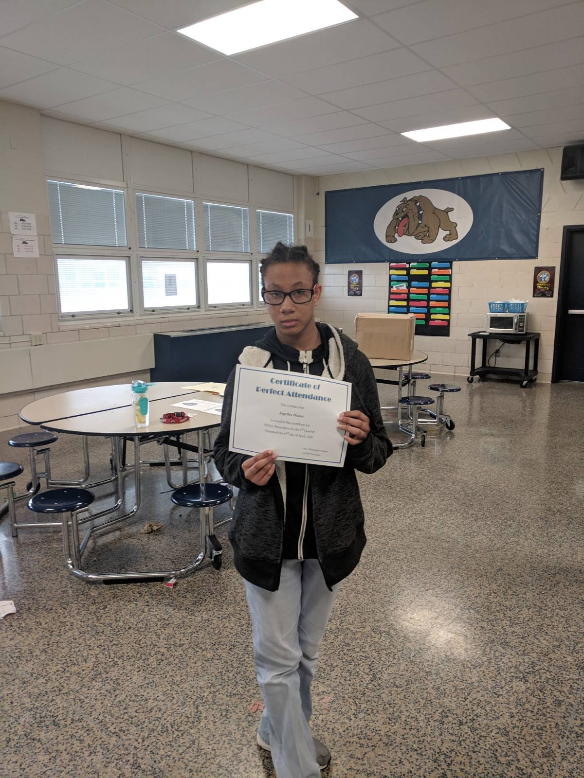 Student with positive behavior certificate