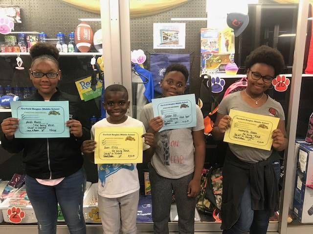 Four students holding their PBIS Certificates