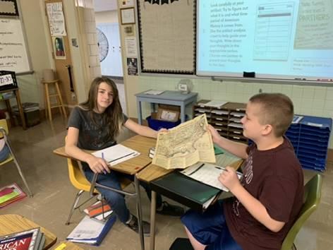 Students examining a map.