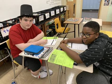 Student wearing a stovepipe hat.