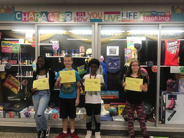 Students with their Positive Referral certificates.