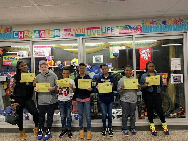Students holding their PBIS certificates.