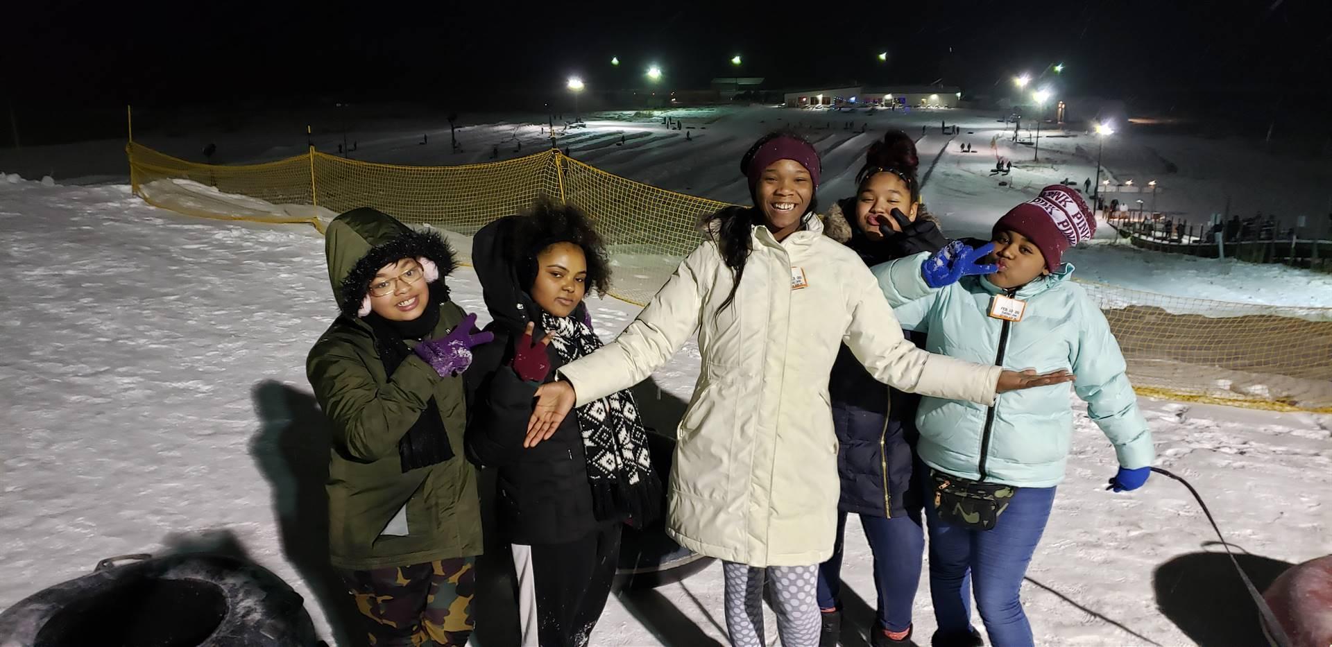 Students snow tubing