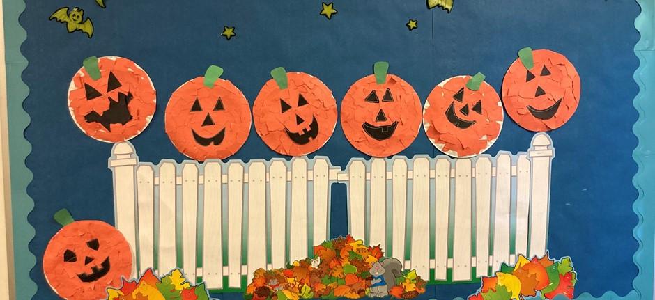 Pumpkins on a fence bulletin board